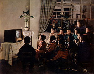 Photograph of children watching TV